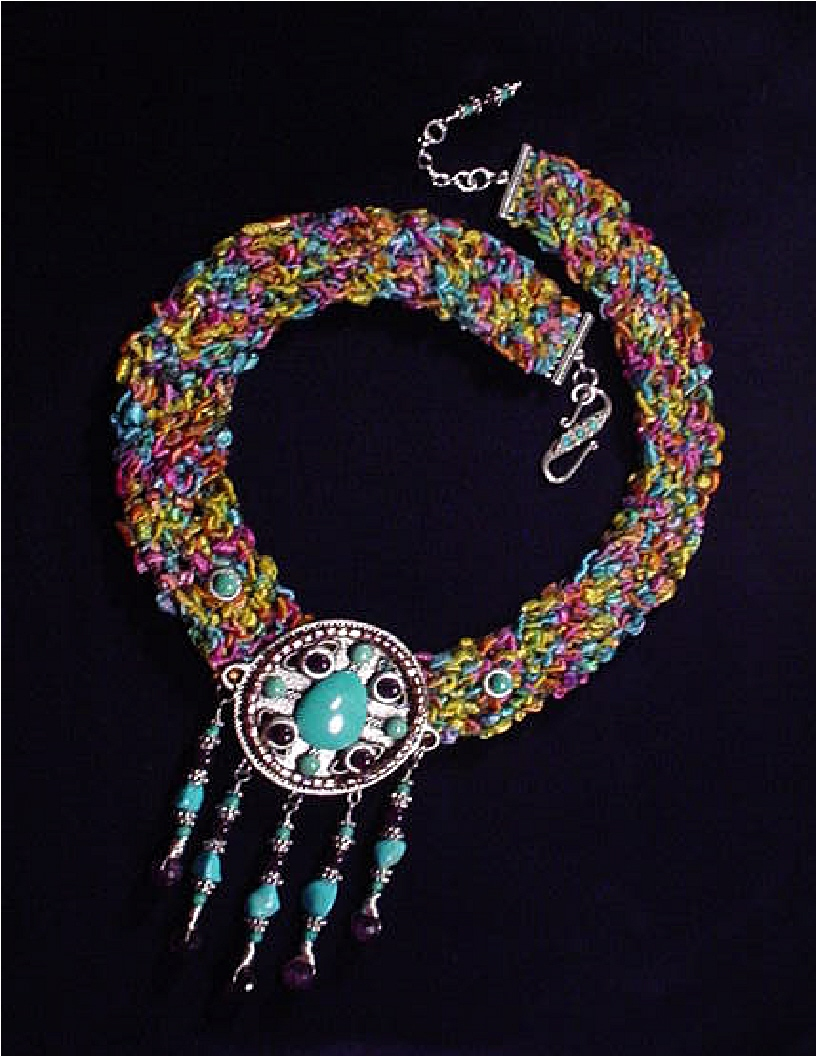 Handcrafted Fiber Crochet Turquoise Necklace - Handcrafted crochet with fibers. Metal Silver medallion. Chinese, Kingman, Sleeping Beauty Turquoise and A Grade Amethyst. Sterling Silver findings and clasp. Limited production