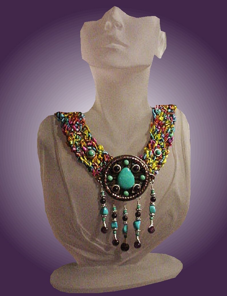 Handcrafted Fiber Crochet Turquoise Necklace - Handcrafted crochet with fibers. Metal Silver medallion. Chinese, Kingman, Sleeping Beauty Turquoise and A Grade Amethyst. Sterling Silver findings and clasp. Limited production.