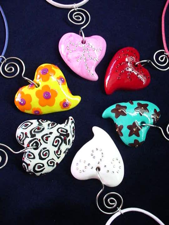 St. Valentine's Heart Pendant Necklaces-Handmade with glazed Fimo. Embellished with Austrian crystals. Leather cord, nickel wire and silver plated findings are used for final details. Perfect to match with any personal style. Handmade Crafts