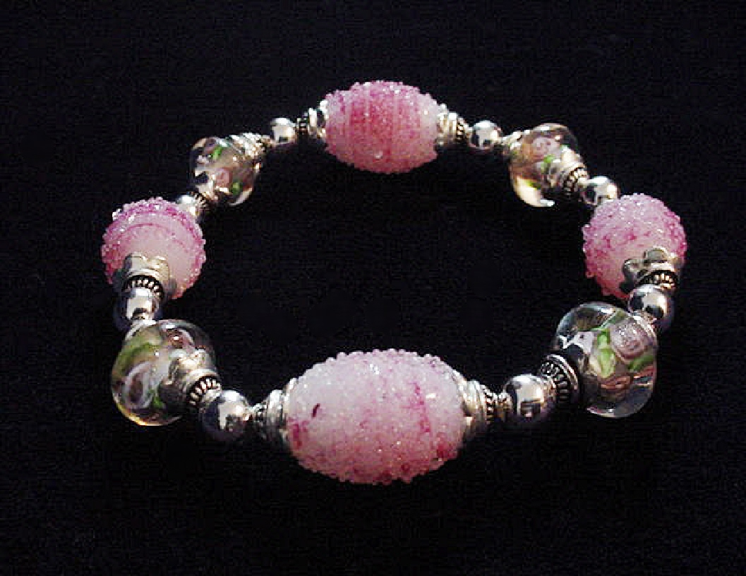 Handcrafted Jewelry Pink Glass Beads Bracelet-Handcrafted with Pink and White Large oval and medium round Glass beads. Transparent Lampwork pink roses flower glass beads are used for a floral and romantic look. Embellished with Silver plated beads and findings. Stretch cord is used for bracelet band. Beautiful and Elegant!