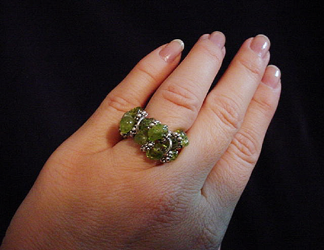 Handcrafted Semi-precious Stones Rings-Handcrafted with Semi-precious Stones Chips, Sterling Silver and Silver Plated findings and beads. Stretch cord is used to give flexibility. Only the Peridot ring (shown in hand) has two rows, the rest are only with one row. Beautiful to wear anytime.